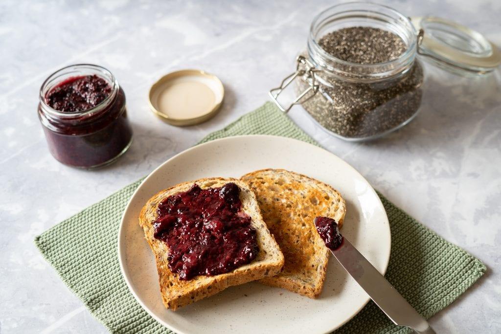 blackberry chia jam on toast on table