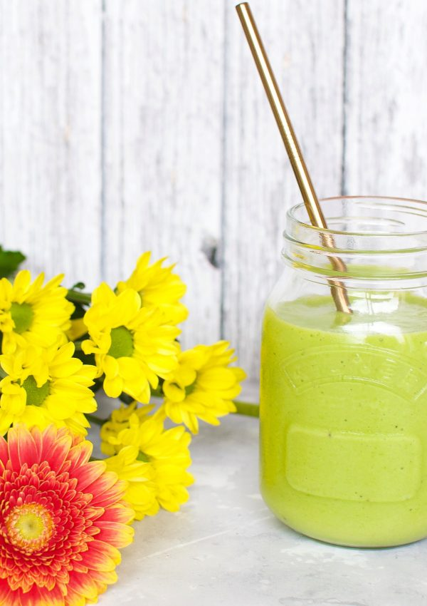 Green mango smoothie in mason jars with metal straws