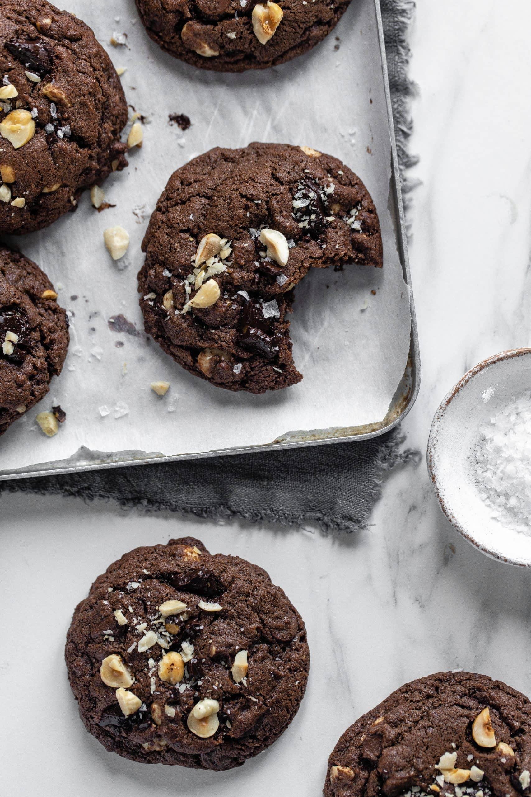 double chocolate hazelnut cookies on tray with salt
